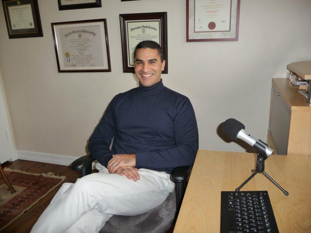 Photo of Dr. Fawaz Al-Malood podcasting